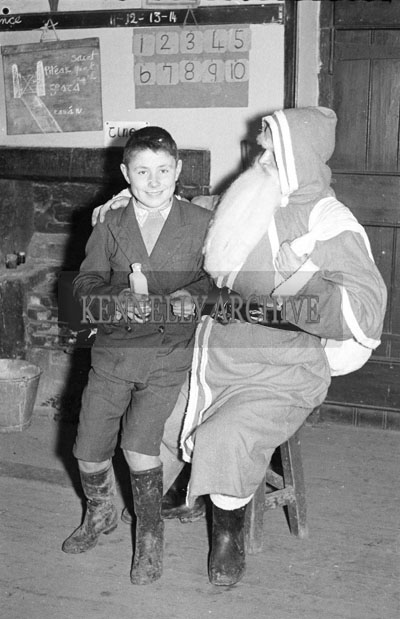 December 1957; A photo of Santa with a student at Realt na Mara National School.