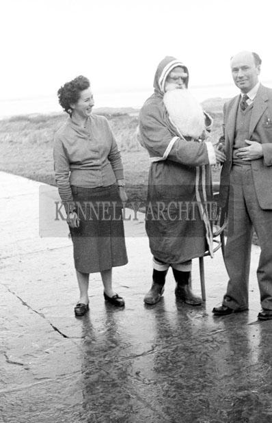 December 1957; A photo of Santa with teachers at Realt na Mara National School.