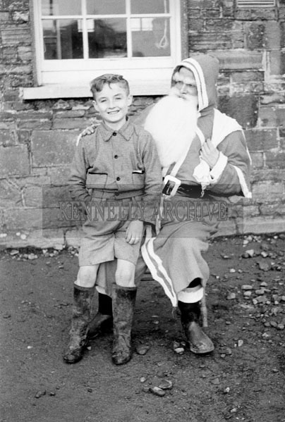 December 1957; A photo of Santa with a student at Knockbrack National School.