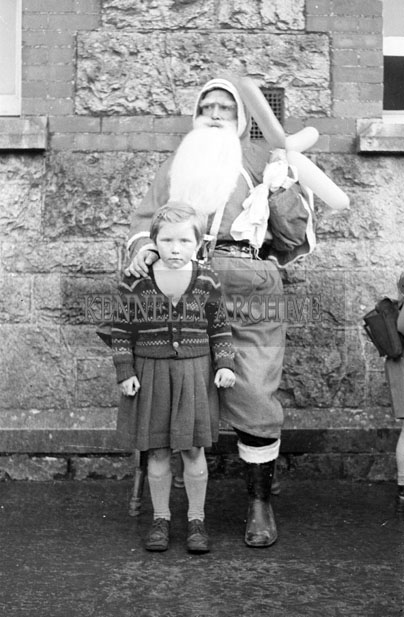 December 1957; A photo of Santa with a student in a convent school in Castleisland.