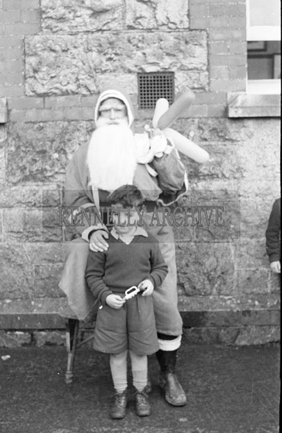 December 1957; A photo of Santa with a student at a convent school in Castleisland.