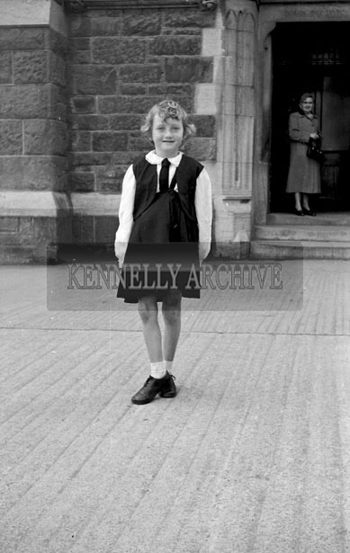 April 1957; An Irish Dancer from the Laide school of Dance, Tralee, taken in front of the Holy Cross Dominican Church on Easter Sunday.