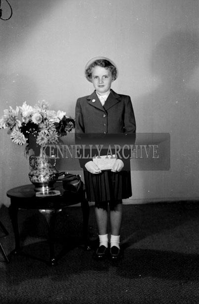 September 1957; A studio photo of a girl.