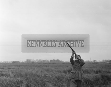 January 1962; John Paul Doyle out shooting at an unknown location.