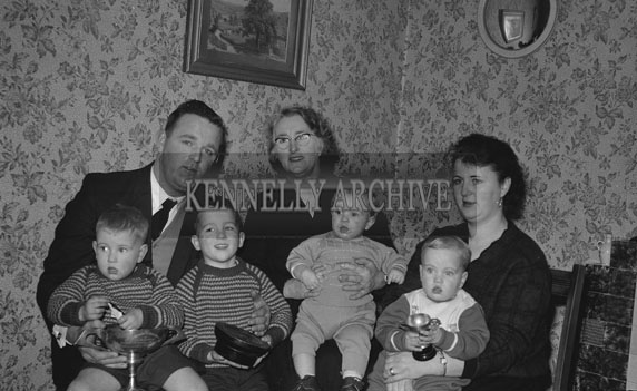 January 1962; The family of All-Ireland Junior Hurling Captain Michael Hennessy pose for the camera at home in Ballyduff.