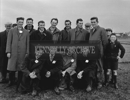 17th January 1962; A group of people pose for the camera  at a ploughing match which took place in Abbeydorney.