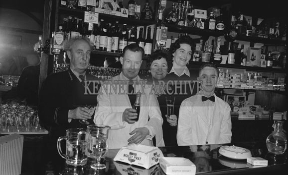 27th January 1962; Porter Paddy Geary (left) and Benners Hotel Staff during the Annual Tralee Chamber of Commerce Dinner.