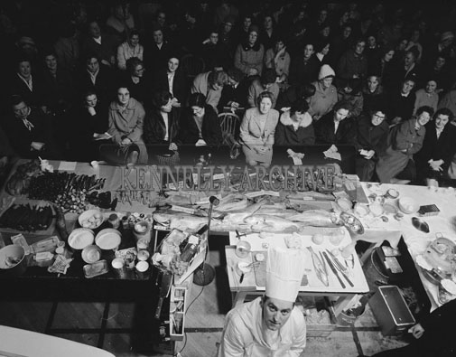 9th February 1962; A group of people watching Chef William Ryan (Executive Chef at Shannon Airport) demonstrating how to cook fish at the KPH in Tralee. The Chef was presented by the Fishing Industry Development Committee.
