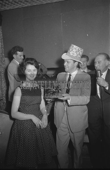 14th October 1962; A man showing a hat to a woman at a dance which took place in Ballymacelligott.