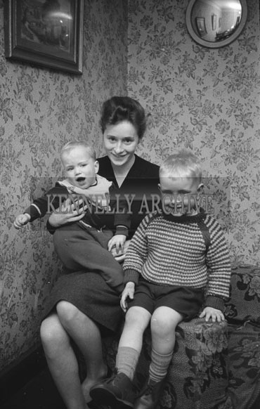 January 1962; Members of the Hennessy family pose for the camera at home in Ballyduff.