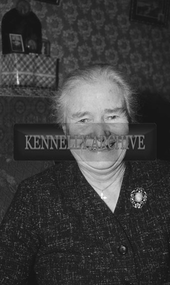 February 1962; A photo of a woman taken at home at an unknown location.