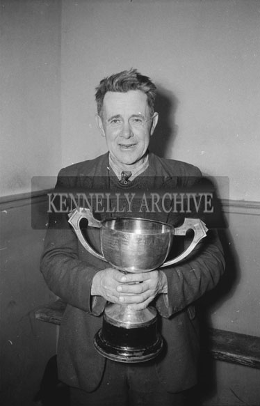 February 1962; A man with a trophy at a dance which took place in Abbeydorney.