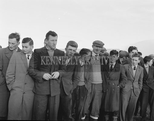 18th February 1962; A group of turfcutters pose for the camera at the Taodh Fhod Munster Championship which took place in Duagh where M O'Connor was crowned the winner.