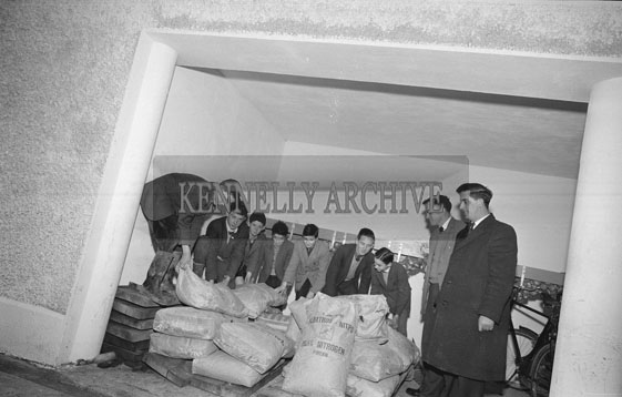 March 1962; Bobby Buckley (second from left) and Rural Science students at Causeway Technical School with a consignment of fertilizer presented to the school by the Albatross Fertilizer Company Ltd. The fertilizer was to be used as a plant food element on the experimental farm attached to the school.