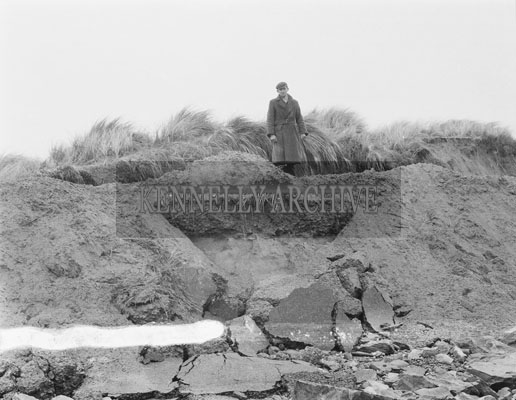 March 1962; A photo showing road damage to the Maharees after high tides driven by gale force winds caused extensive flooding.