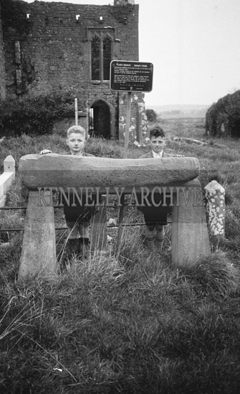 February 1962; Tw oboys with an Ogham Stone in Kerry.