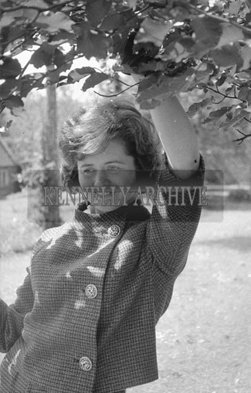 18th May 1962; A woman poses for the camera on Communion Day in Dingle.