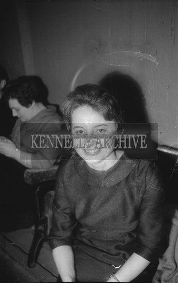 22nd November 1962; A woman poses for the camera at a dance which took place in Rathmore.