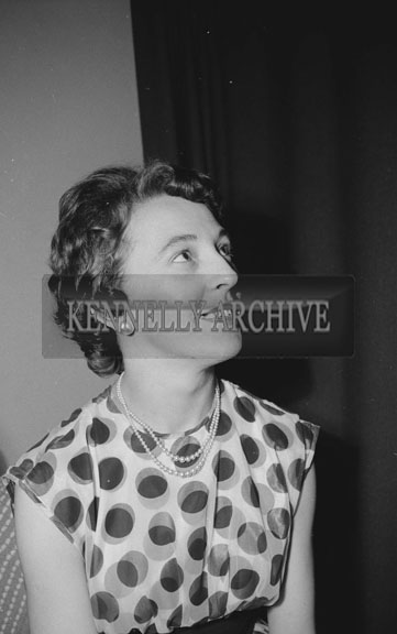24th February 1962; A woman poses for the camera at the Kerins O'Rahilly's Social which took place at the Meadowlands Hotel. The music on the night was provided by the Kingdomaires Showband.