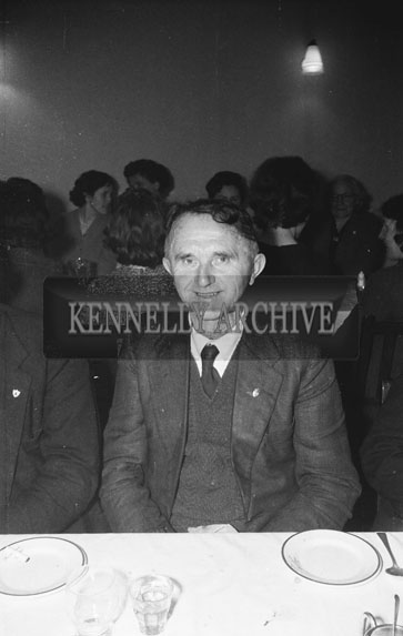 February 1962; A man poses for the camera at a social in Ballyduff.