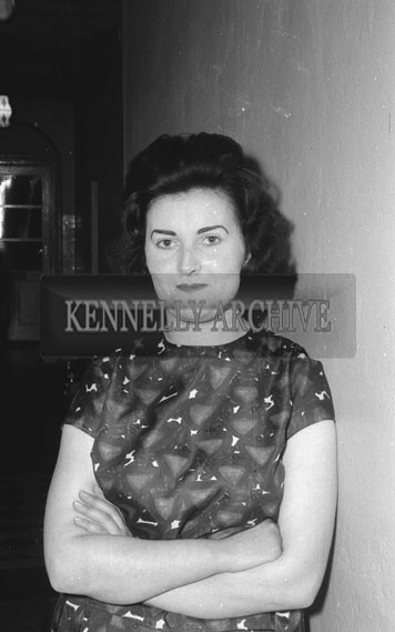 February 1962; A woman poses for the camera at a social in Ballyduff.