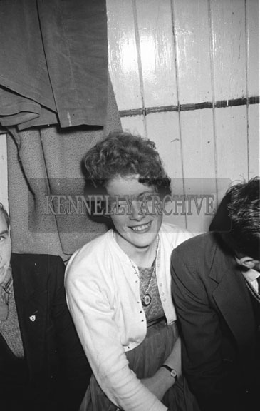 5th December 1962; A woman poses for the camera at a dance which took place in Lixnaw with music provided by Denis Cronin and his Orchestra.