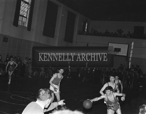 18th March 1962; An action photo taken at the Tralee Town Basketball League Final where the Rebels defeated the ESB team 40 points to 39 points.