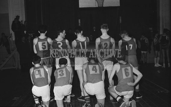 March 1962; A photo of an unknown Basketball Team taken at the CYMS in Tralee.