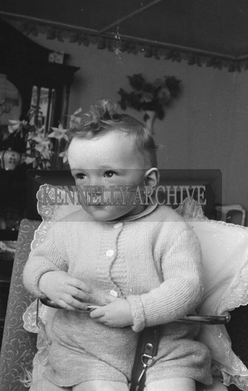 April 1962; A photo taken of a baby at home at an unknown location.