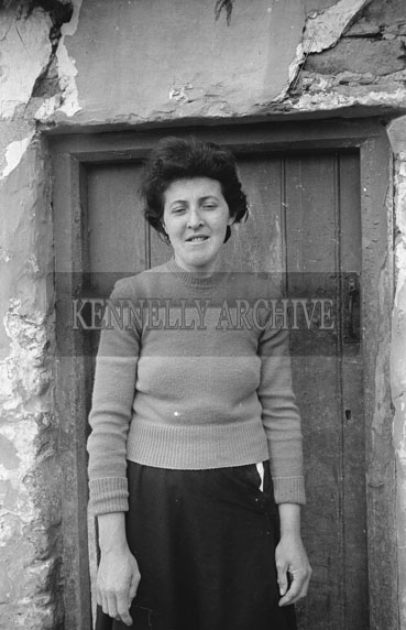May 1962; A photo of a woman taken outside a house in Brandon.