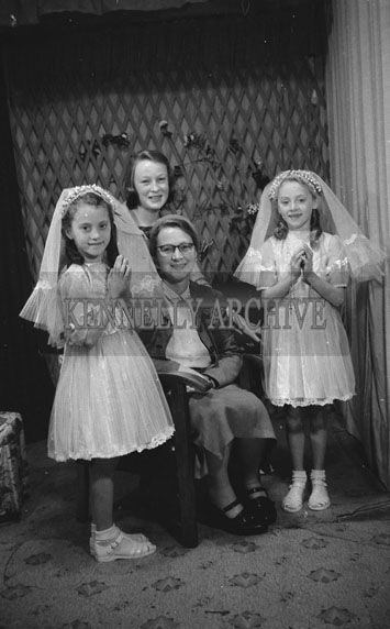 June 1962; A Communion photo of a family taken at the studio in Tralee.