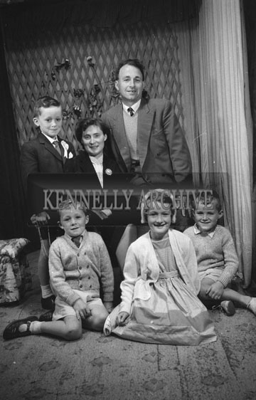 June 1962; A Communion photo of a boy and his family taken at the studio in Tralee.