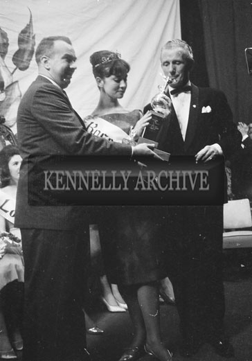 3rd September 1962; Ciara O'Sullivan, the Dublin Rose is crowned the winner of the Rose Of Tralee at the Ashe Memorial Hall in Tralee. Compere Kevin Hilton is on the right.