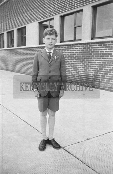 September 1962; A Confirmation photo of a boy taken outside the CBS in Tralee.