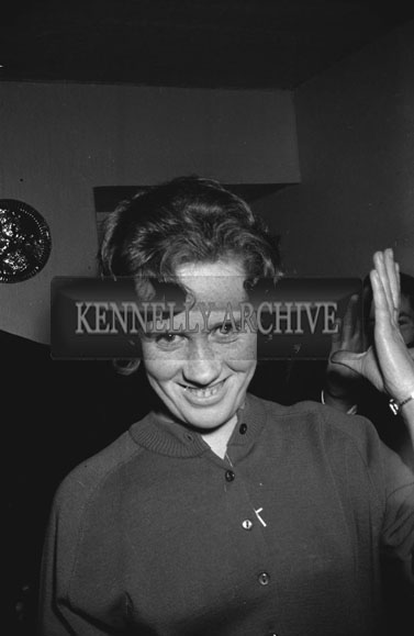 2nd December 1962; A woman poses for the camera at the Kerins O'Rahilly's Social which took place at the Meadowlands Hotel.