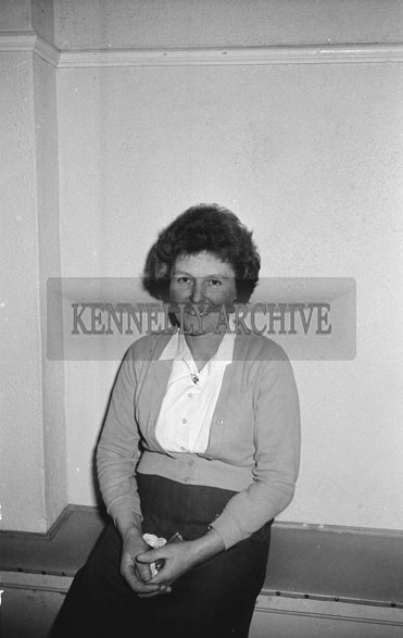 9th December 1962; A woman poses for the camera at a dance which took place in Firies.