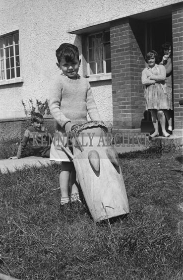 20th May 1962; A group of children playing a Tom Tom Drum in Ballybunion. The drum was found by Denis Nagle of Marian Crescent on the beach in Ballybunion. Carved from a single piece of wood, it was thought that the drum originated from the Pacific Islands.