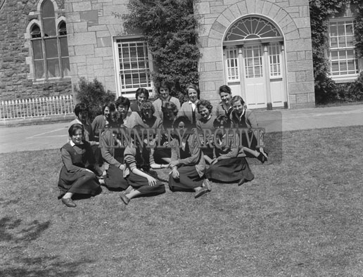 September 1962; A group of girls pose for the camera outside the convent on Communion Day in Castleisland.