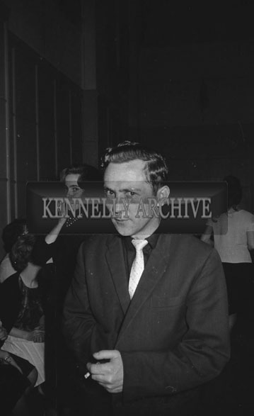 14th December 1962; A man poses for the camera at a dance which was held the the CYMS Hall in Tralee.