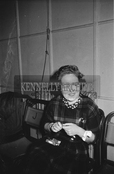14th December 1962; A woman poses for the camera at a dance which was held the the CYMS Hall in Tralee.