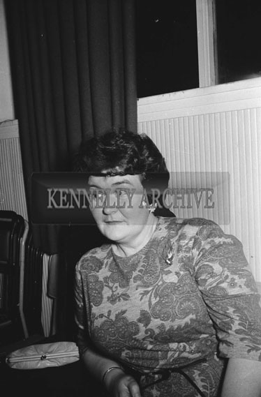 15th December 1962; A woman poses for the camera at the CIE Social which took place at the Hotel Manhattan.