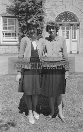 September 1962; Two girls pose for the camera outside the convent on Communion Day in Castleisland.