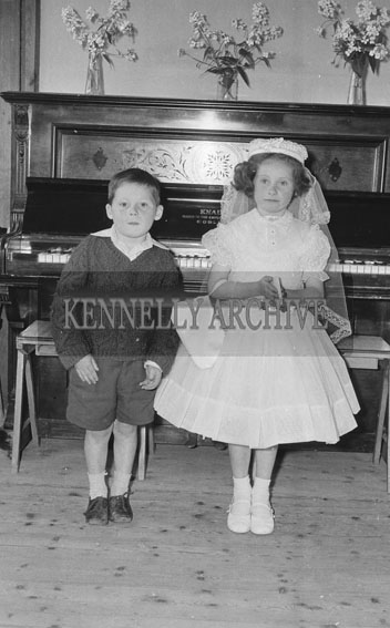 September 1962; A Communion photo of a girl with her sibling taken at an unknown location.