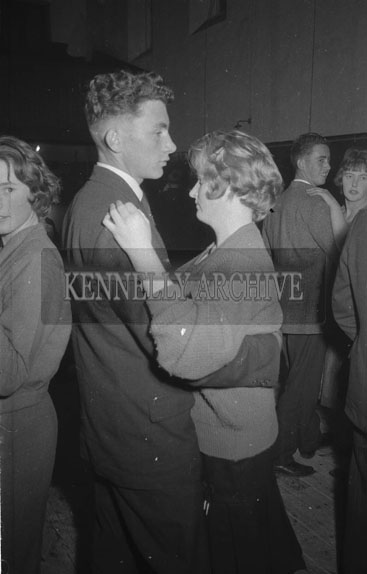 February 1962; People enjoying the night at a dance at an unknown location.