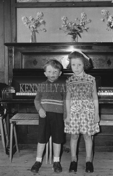 September 1962; Two children pose for the camera at an unknown location.