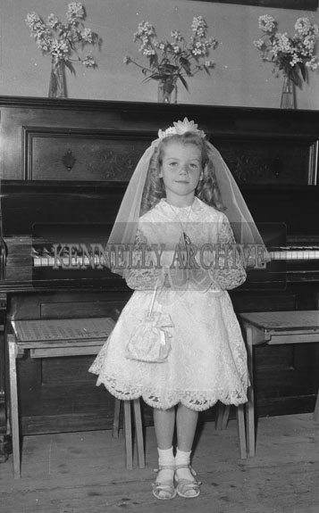 September 1962; A Communion photo of a girl taken at an unknown location.
