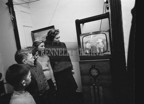 December 1962; A photo taken of a group of children watching 'The Flinstones' on television. Included in the picture is Padraig Kennelly Junior.