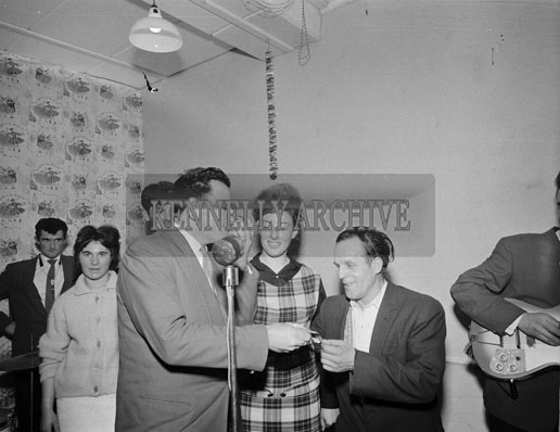 23rd December 1962; The winner receiving a prize after the Twist Competition which took place during a dance in Firies.