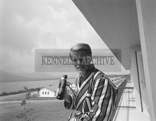 23rd July 1962; Singer Adam Faith takes time to appreciate the view of the lakes from the balcony of his room at the Hotel Europe.