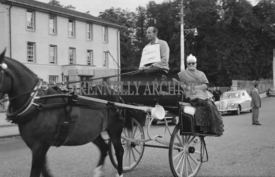 July 1962; People in costume parade through the town on Jaunting Cars during a fancy dress parade which took place in Killarney.